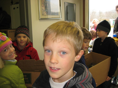 Pomfret School Kids Can The Pomfret School delivered food to the Woodstock Food Shelf as part of their fifth year of involvement in Kids CAN Help. Photos provided by Barb Leonard and Chipper