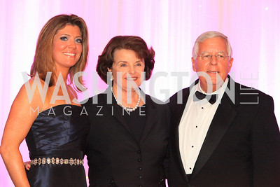 Norah O'Donnell, Sen. Dianne Feinstein (D-Calif.), Sen. Mike Enzi (R-Wyo.). The 32nd Annual Ambassadors Ball. Photos by Alfredo Flores.