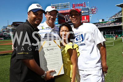 Nico Sanderberg, D.C. Council Chairman Vince Gray, Becky Lee, Carlos Gray. Photo by Alfredo Flores. Becky's Fund Domestic Violence Awareness Day at Nationals Park