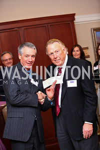 "Photo by Tony Powell. Gordon Hay receiving a $250,000 check from Dick Patterson. Cocktail reception to celebrate the success of the Joan Hisaoka ""Make a Difference"" Gala. Life with Cancer Center. December 9, 2010"