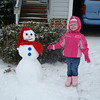 Abby posing with the snowman we made.