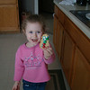 Abby is proud of the snowman cookie she made