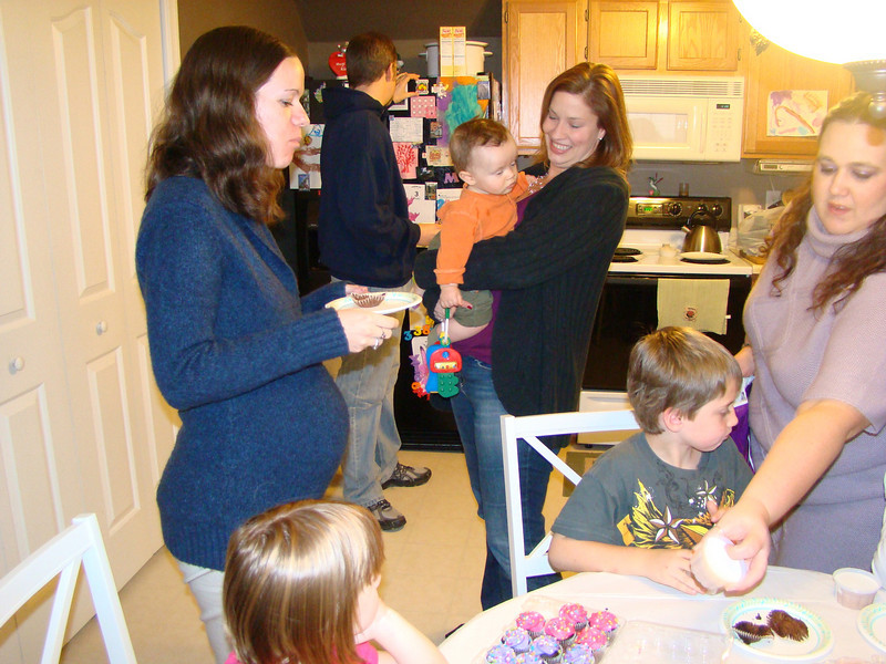 Erin, Stef with Jaxon and Diane handing out ice cream to the kids