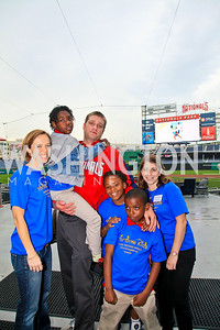 Kim Atkinson, Will Griffith, Carly Roberts with Horton's Kids participants. Photo by Tony Powell. Home Runs for Horton's Kids. Nationals Park. May 12, 2010