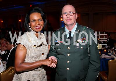Photo by Tony Powell. Night of Heroes Gala. Ritz Carlton. June 3, 2010. Condoleeza Rice, Sgt. Stewart Lundsford
