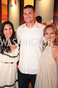 Aixa Julia, Washington National's Craig Stammen, Olga Julias. Ryan Zimmerman's A Night at the Park. Photos by Alfredo Flores