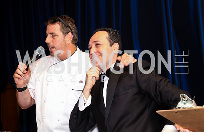 "Photo by Tony Powell. Chef Robert Wiedmaier, Auctioneer Sam Solovey. Starlight ""Bedtime Bash"". Four Seasons Hotel. November 20 2010"
