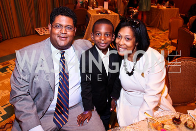Photo by Tony Powell. THEARC Exec. Dir. Edmund Fleet, Victor and Ericka Fleet. Tea with Mrs. B to Benefit THEARC. Four Seasons. October 17, 2010