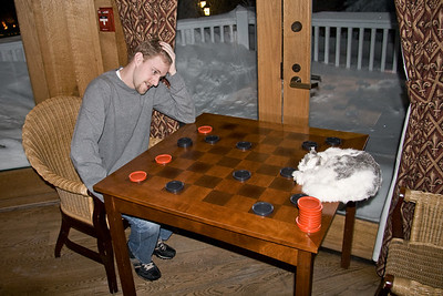 "Jon ""The Scenester"" set up some key positions early in the game but soon found himself in a world of hurt as Mr. Hootenanny sliced and diced his black checkers across the board."