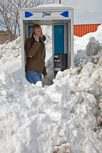 Just as we were eating, Jon's beeper started going off like crazy so he had to scale the snow pile and call the shop