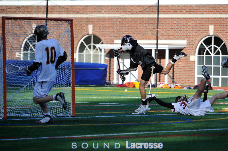Conner Bernal drives the ball into the net past Nick Canino