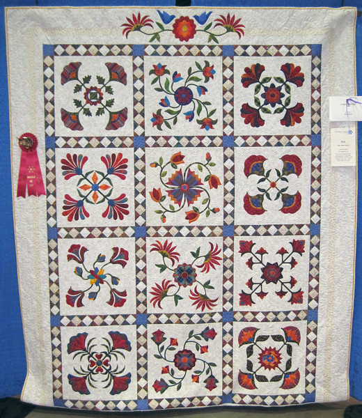 Second Place<br /> The Happy Quilt<br /> Jeanie Pollard