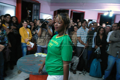 "Prostitute Maria wears a creation during the Daspu Football Club fashion show at a hotel in Rio downtown, Rio de Janeiro, Brazil, June 2, 2010. In the T-shirt says: 'Put it in [the net], Selecao!"". Sex workers organisation Daspu, a wordplay on the expression 'Das Putas', that means 'the hookers' in Portuguese, are cashing in on the country's football delirium by selling their own t-shirt designs with messages of support for Brazil's World Cup squad. (Austral Foto/Renzo Gostoli)"