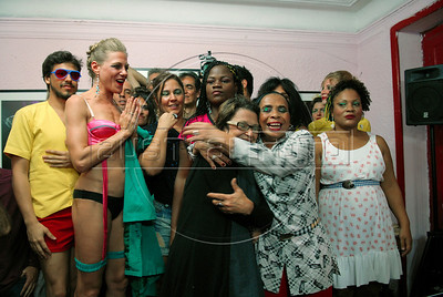 Participants celebrate with Gabriela Leite, center, director of non-governmental  organisation Davida, at final of Daspu Football Club fashion show at a hotel in Rio downtown, Rio de Janeiro, Brazil, June 2, 2010. Sex workers organisation Daspu, a wordplay on the expression 'Das Putas', that means 'the hookers' in Portuguese, are cashing in on the country's football delirium by selling their own t-shirt designs with messages of support for Brazil's World Cup squad. (Austral Foto/Renzo Gostoli)