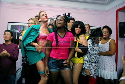 Prostitutes wear creations during the Daspu Football Club fashion show at a hotel in Rio downtown, Rio de Janeiro, Brazil, June 2, 2010. Sex workers organisation Daspu, a wordplay on the expression 'Das Putas', that means 'the hookers' in Portuguese, are cashing in on the country's football delirium by selling their own t-shirt designs with messages of support for Brazil's World Cup squad. (Austral Foto/Renzo Gostoli)