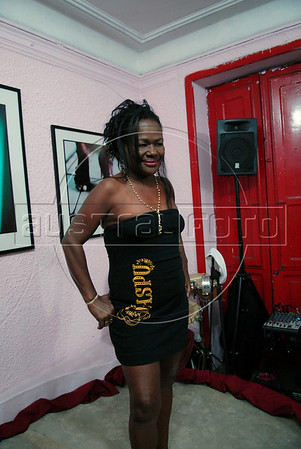 A prostitute wears a creation during the Daspu Football Club fashion show at a hotel in Rio downtown, Rio de Janeiro, Brazil, June 2, 2010. Sex workers organisation Daspu, a wordplay on the expression 'Das Putas', that means 'the hookers' in Portuguese, are cashing in on the country's football delirium by selling their own t-shirt designs with messages of support for Brazil's World Cup squad. (Austral Foto/Renzo Gostoli)