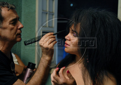 A prostitute prepares backstage before to taking part at Daspu Football Club fashion show at a hotel in Rio downtown, Rio de Janeiro, Brazil, June 2, 2010. Sex workers organisation Daspu, a wordplay on the expression 'Das Putas', that means 'the hookers' in Portuguese, are cashing in on the country's football delirium by selling their own t-shirt designs with messages of support for Brazil's World Cup squad. (Austral Foto/Renzo Gostoli)