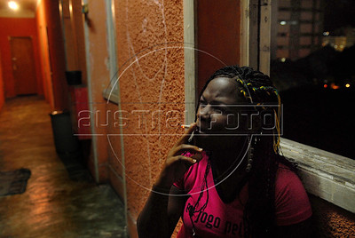 A prostitute waits before to taking part at Daspu Football Club fashion show at a hotel in Rio downtown, Rio de Janeiro, Brazil, June 2, 2010. Sex workers organisation Daspu, a wordplay on the expression 'Das Putas', that means 'the hookers' in Portuguese, are cashing in on the country's football delirium by selling their own t-shirt designs with messages of support for Brazil's World Cup squad. (Austral Foto/Renzo Gostoli)