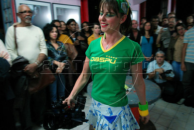 A participant performs during the Daspu Football Club prostitutes fashion show at a hotel in Rio downtown, Rio de Janeiro, Brazil, June 2, 2010. Sex workers organisation Daspu, a wordplay on the expression 'Das Putas', that means 'the hookers' in Portuguese, are cashing in on the country's football delirium by selling their own t-shirt designs with messages of support for Brazil's World Cup squad. (Austral Foto/Renzo Gostoli)