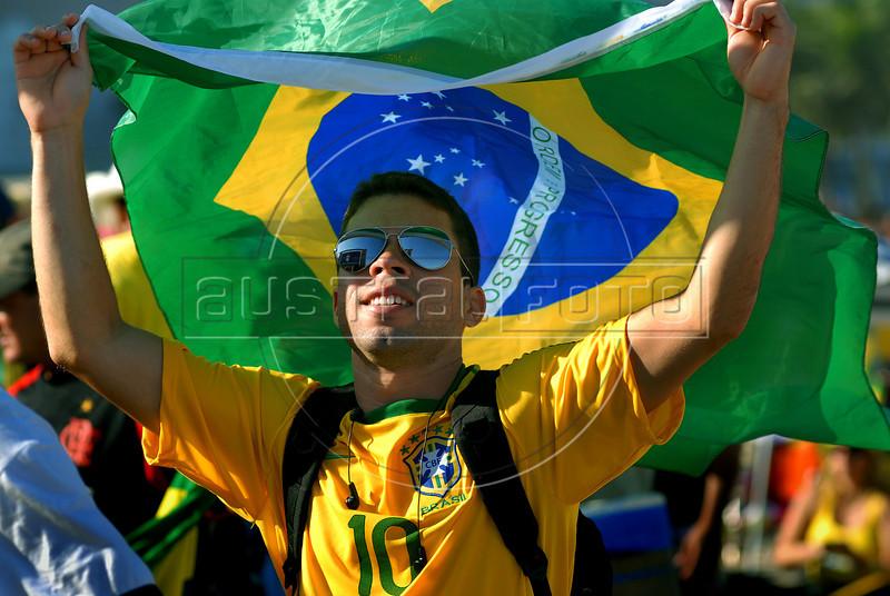 A Brazilian fan reacts during the South Africa 2010 World Cup soccer match between Brazil and Ivory Coast on Copacabana beach, Rio de Janeiro, Brazil, June 20, 2010 (AustralFoto<br /> /Renzo Gostoli)