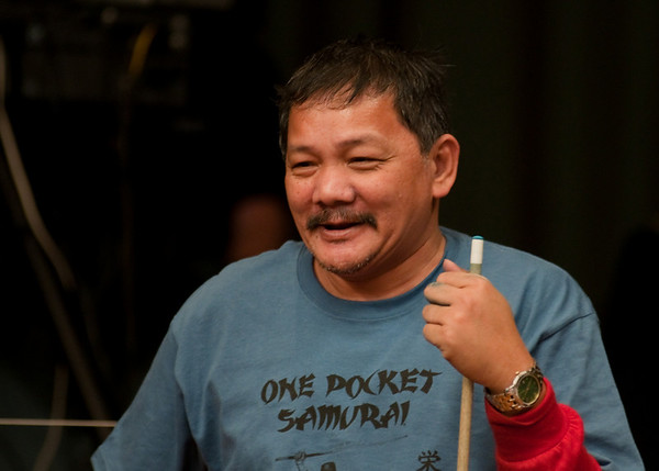 Efren -- playing 10-ball in a One Pocket shirt