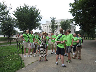 Tour guide Linda Mason talks to the group. Lincoln Memorial in the background.