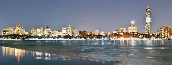 A sunset view of Boston across the Charles River from Cambridge at winter night