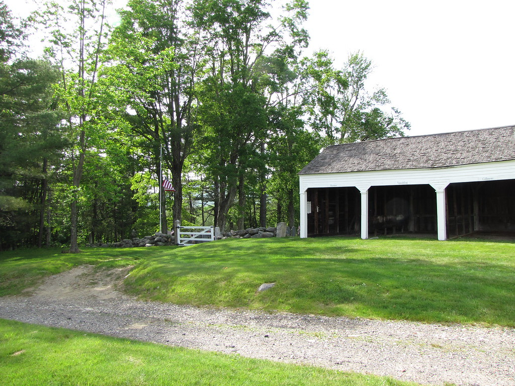 "Stables behind Meeting House (used to ""park"" horses). White gate is entrance to old burial grounds."
