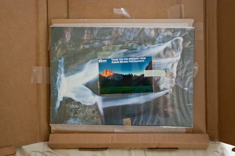 "In this photo you can see the canvas photo after i opened up the flaps on the box from Bay Labs. Everything was super well packaged in this. The canvas board was surrounded by plenty of cardboard and there was no way to accidentally cut the canvas when opening the box. Additionally, on another board behind this were the 2 larger prints.   You can also see the ""Thank You"" card that SmugMug prints with all my packages!"