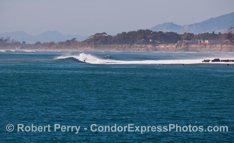 Surfers - Santa Barbara coastal reef break.