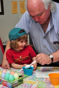 Grandpa and Anya dyeing Easter eggs