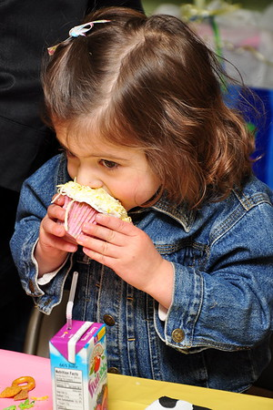 Lily enjoying her birthday cupcake.