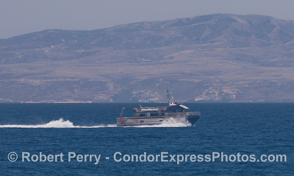 "The Channel Islands National Marine Sanctuary research vessel ""Shearwater"" heads west along the northern face of Santa Rosa Island."