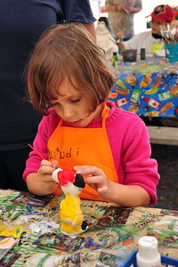Cailyn painting pottery while camping