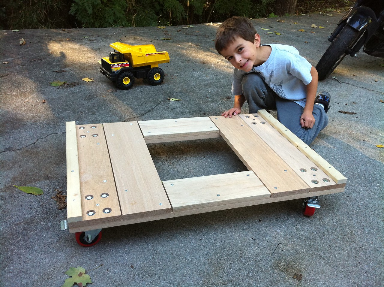 The server cabinet dolly that I built (standard construction dump truck and giant human child included for scale)