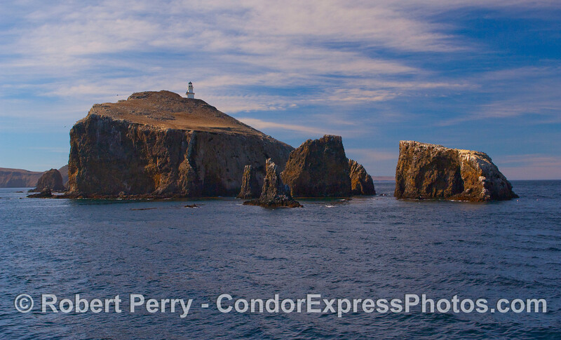 Anacapa Island in the afternoon sun, this is the East End with Anacapa Light atop the bluff and Arch Rock is the rock to the far right.