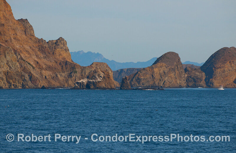 Cat Rock, Anacapa Island, looking north east from the south side of the island.  For a sense of scale, note the yacht to the right edge.