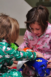 Anya & Cailyn opening a Christmas present