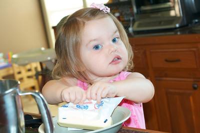 Anna is such a big helper in the kitchen!