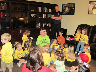 Shawn the Fireman is showing the class the living room.