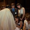 Father Burns anoints Ellen