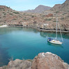 Hello World lying to a bow and stern anchor in Honeymoon Cove on Isla Danzante.