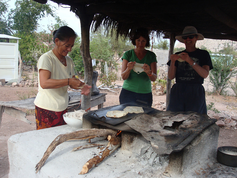 The gringos learning how to make wood-fired tortillas.