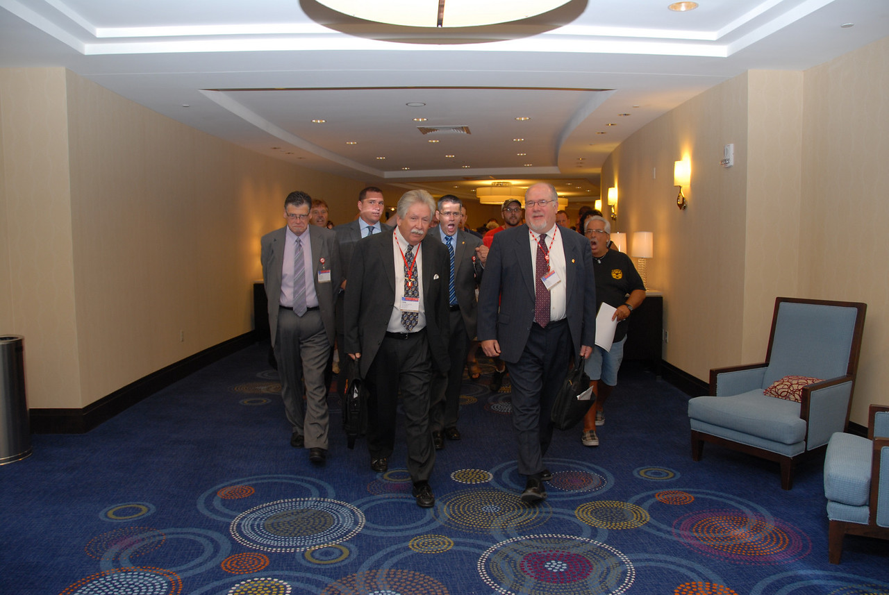 District One VP Chris Shelton leads the march onto the Convention floor.