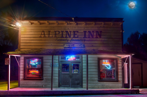 "Alpine Inn During Moonlit Night Taken on May 26, 2010 in Portola Valley, CA  Here you can see the original file after processing it in Photomatix Pro and Photoshop. I even applied some ""perspective"" fixing. Adobe Lightroom 3 has a new feature in which it can correct for lens distortion. In this version I applied some of the geometric perspective fixes to fix the inward bow of the Alpine Inn. Unfortunately, it has to do some cropping and it got rid of some of the moon and ground leading up to the inn (which I liked).  Thoughts?"