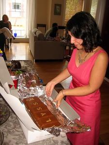 Alyssa unwraps her cake