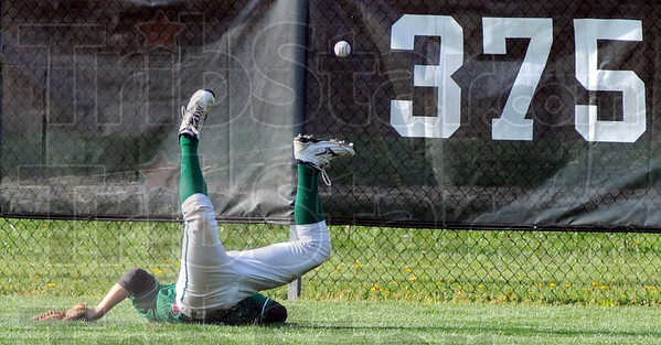 Dive drive: West Vigo's centerfielder, (insert name) dives for a hard-hit ball deep in center field during game action against North Vermillion Thursday evening.