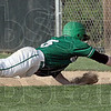 Back: West Vigo's #6, Cody Wheat dives back safely to first base during a pick-off attempt Thursday afternoon.