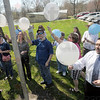 Balloon launch: Several people attending Thursday's Autism event prepare to launch balloons.