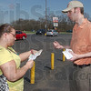 In your hands: Megan Jenkins reads  the census reminder card she just accepted from Jamie McDowell of the Terre Haute Chamber of Commerce. Volunteers were at several sites Thursday in addition to stacks of the cards being available at area restaraunts.